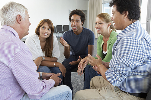 small group of adults in conversation